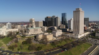 DX0002_114_009 - 5.7K stock footage aerial video descend and orbit Tennessee State Capitol, skyscrapers, Tennessee Tower in Downtown Nashville, Tennessee