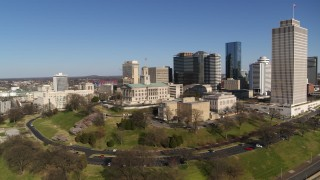 DX0002_114_010 - 5.7K stock footage aerial video orbit Tennessee State Capitol near tall skyscrapers in Downtown Nashville, Tennessee