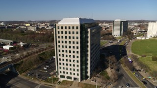 DX0002_114_012 - 5.7K stock footage aerial video orbit Andrew Johnson Tower, a government office building in Downtown Nashville, Tennessee