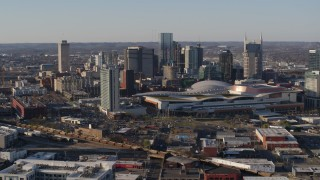 DX0002_114_015 - 5.7K stock footage aerial video stationary and passing view of convention center and skyline in Downtown Nashville, Tennessee