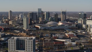 DX0002_114_024 - 5.7K stock footage aerial video of flying away from the city skyline behind the convention center in Downtown Nashville, Tennessee
