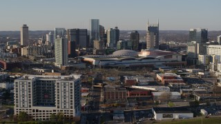 DX0002_114_025 - 5.7K stock footage aerial video of slowly flying toward the city skyline and the convention center in Downtown Nashville, Tennessee