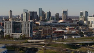 DX0002_114_027 - 5.7K stock footage aerial video of the city skyline and convention center, reveal I-65 in Downtown Nashville, Tennessee