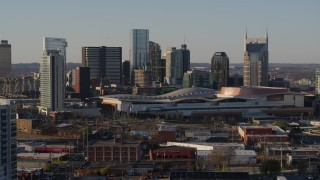 DX0002_114_035 - 5.7K stock footage aerial video flying past city's tall skyline by the convention center in Downtown Nashville, Tennessee