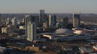 DX0002_114_039 - 5.7K stock footage aerial video the city's tall skyline by the convention center in Downtown Nashville, Tennessee