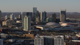 DX0002_114_040 - 5.7K stock footage aerial video reverse view of city's tall skyline beside Nashville Music City Center in Downtown Nashville, Tennessee