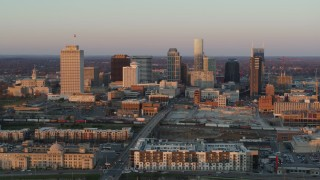 DX0002_115_001 - 5.7K stock footage aerial video of the city's skyline at sunset before descending in Downtown Nashville, Tennessee