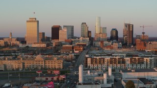 DX0002_115_004 - 5.7K stock footage aerial video of a reverse view of the city's skyline at sunset in Downtown Nashville, Tennessee