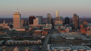 DX0002_115_006 - 5.7K stock footage aerial video of a reverse view of the city's skyline at sunset during ascent in Downtown Nashville, Tennessee