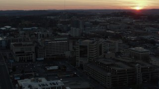 DX0002_115_017 - 5.7K stock footage aerial video approach hospital complex and ascend with view of setting sun, Nashville, Tennessee