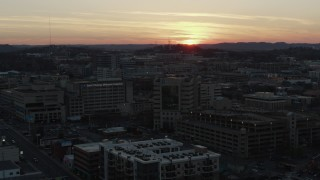 DX0002_115_018 - 5.7K stock footage aerial video a hospital complex with view of setting sun, seen during descent and orbit, Nashville, Tennessee