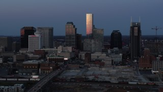 DX0002_115_020 - 5.7K stock footage aerial video of flying by the city's skyline at twilight in Downtown Nashville, Tennessee