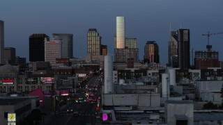 DX0002_115_023 - 5.7K stock footage aerial video flashing lights on Church Street and view of city's skyline at twilight in Downtown Nashville, Tennessee