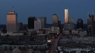 DX0002_115_025 - 5.7K stock footage aerial video light reflecting off skyscrapers in city's skyline, descend near Church Street at twilight in Downtown Nashville, Tennessee