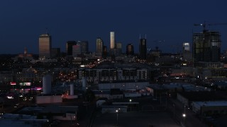 DX0002_115_032 - 5.7K stock footage aerial video wide view of skyscrapers reflecting light in the city skyline at twilight in Downtown Nashville, Tennessee