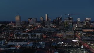 DX0002_115_033 - 5.7K stock footage aerial video wide view of the city skyline and high-rise under construction at twilight, Downtown Nashville, Tennessee