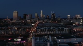 DX0002_115_035 - 5.7K stock footage aerial video ascend near Church Street to approach city skyline at twilight, Downtown Nashville, Tennessee