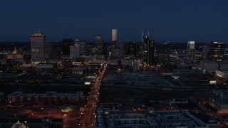 DX0002_115_036 - 5.7K stock footage aerial video reverse view of Church Street and city skyline at twilight, Downtown Nashville, Tennessee