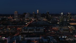 DX0002_115_037 - 5.7K stock footage aerial video flyby Church Street and city skyline at twilight, reveal high-rise construction, Downtown Nashville, Tennessee