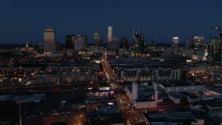 DX0002_115_039 - 5.7K stock footage aerial video flashing lights and traffic on Church Street and city skyline, Downtown Nashville, Tennessee