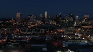 DX0002_115_041 - 5.7K stock footage aerial video ascend and flyby the city skyline at twilight, Downtown Nashville, Tennessee