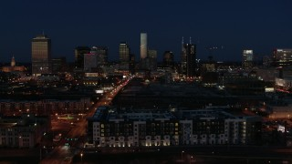 DX0002_115_043 - 5.7K stock footage aerial video slowly pass the city skyline at twilight and ascend, Downtown Nashville, Tennessee