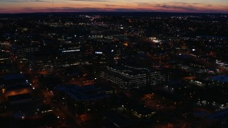 DX0002_115_047 - 5.7K stock footage aerial video slowly orbit and approach a hospital complex at twilight, Nashville, Tennessee