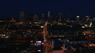 DX0002_115_050 - 5.7K stock footage aerial video flying by Church Street and the city skyline at night, Downtown Nashville, Tennessee