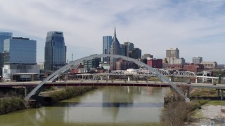 DX0002_116_009 - 5.7K stock footage aerial video stationary view of bridge and skyscrapers in Downtown Nashville, Tennessee