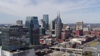 DX0002_116_011 - 5.7K stock footage aerial video of flying by skyscrapers and reveal an office high-rise in Downtown Nashville, Tennessee