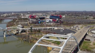 DX0002_116_017 - 5.7K stock footage aerial video of Nissan Stadium seen from a bridge in Nashville, Tennessee