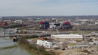 DX0002_116_042 - 5.7K stock footage aerial video of Nissan Stadium near bridge, seen from Cumberland River in Nashville, Tennessee