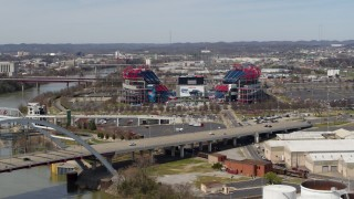 DX0002_116_044 - 5.7K stock footage aerial video approach Nissan Stadium while descending near the bridge in Nashville, Tennessee
