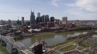 DX0002_117_001 - 5.7K stock footage aerial video of the city's riverfront skyscrapers on the opposite side of the river, Downtown Nashville, Tennessee