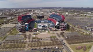 DX0002_117_012 - 5.7K stock footage aerial video circling around Nissan Stadium in Nashville, Tennessee