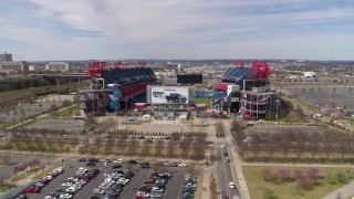 DX0002_117_013 - 5.7K stock footage aerial video descend and orbit Nissan Stadium in Nashville, Tennessee