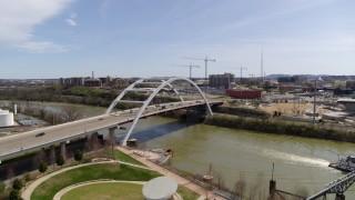 DX0002_117_015 - 5.7K stock footage aerial video orbiting the Korean War Veterans Memorial Bridge in Nashville, Tennessee