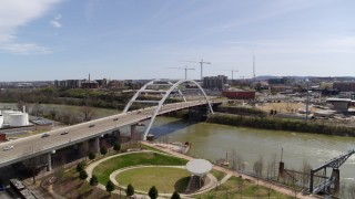 DX0002_117_016 - 5.7K stock footage aerial video orbiting the Korean War Veterans Memorial Bridge as cars cross in Nashville, Tennessee