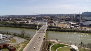 DX0002_117_017 - 5.7K stock footage aerial video ascend and orbit the Korean War Veterans Memorial Bridge as cars cross in Nashville, Tennessee