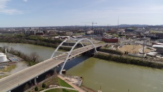DX0002_117_018 - 5.7K stock footage aerial video descending near the Korean War Veterans Memorial Bridge as cars cross in Nashville, Tennessee