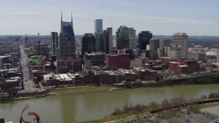 DX0002_117_028 - 5.7K stock footage aerial video a view of city's skyline across the Cumberland River, Downtown Nashville, Tennessee