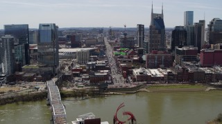 DX0002_117_030 - 5.7K stock footage aerial video busy Broadway across the Cumberland River, Downtown Nashville, Tennessee