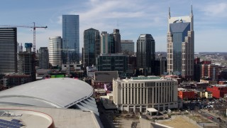 DX0002_117_049 - 5.7K stock footage aerial video of flying past the city's skyline and Hilton hotel, Downtown Nashville, Tennessee