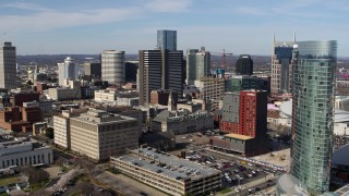 DX0002_118_003 - 5.7K stock footage aerial video approaching and flying by skyscrapers, city buildings in Downtown Nashville, Tennessee