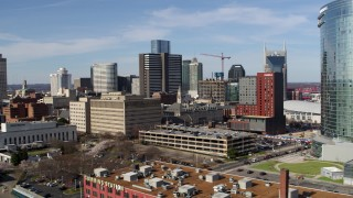 DX0002_118_004 - 5.7K stock footage aerial video descend while flying by skyscrapers and city buildings in Downtown Nashville, Tennessee