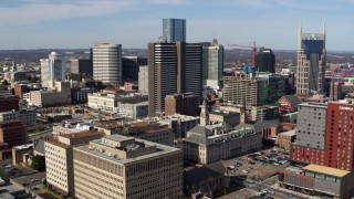 DX0002_118_008 - 5.7K stock footage aerial video of a reverse view of a high-rise hotel and skyscrapers in Downtown Nashville, Tennessee