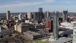 DX0002_118_009 - 5.7K stock footage aerial video of Renaissance Nashville hotel, reveal the JW Marriott in Downtown Nashville, Tennessee