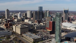 DX0002_118_010 - 5.7K stock footage aerial video flyby JW Marriott for view of Renaissance Nashville and skyscrapers in Downtown Nashville, Tennessee