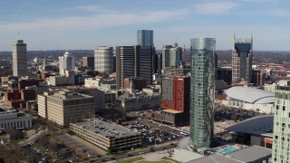 DX0002_118_013 - 5.7K stock footage aerial video orbit the JW Marriott hotel, skyscrapers in background in Downtown Nashville, Tennessee