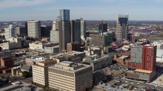 DX0002_118_015 - 5.7K stock footage aerial video stationary view of high-rise hotel and skyscrapers before approach in Downtown Nashville, Tennessee